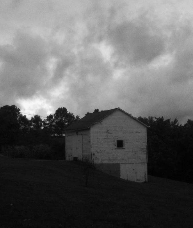 barn in rain clouds