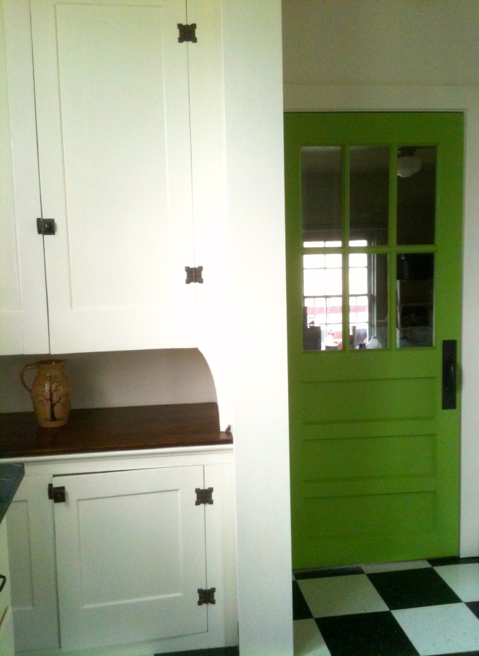 Cabinets and woodwork are Sherwin Williams Steamed Milk semi-gloss