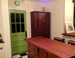 Sapele butcher block top on antique schoolhouse cupboard