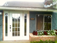 The outside of the house into the mudroom. Aren't the flowers in the planter pretty?
