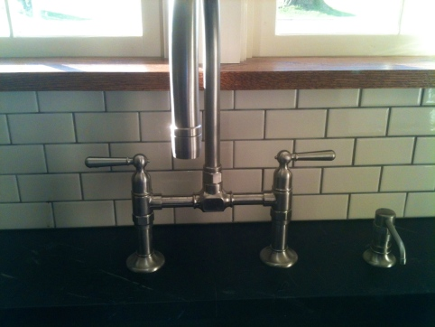 Subway tile, $120, American Olean in Biscuit, from off the shelf in Lowe's. Oak window sill, $25. Faucet, Priceless...