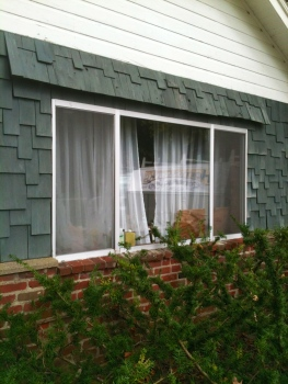 This is a perfect example of the drafty, ugly aluminum windows -- this one is going to be gone SOON as well.