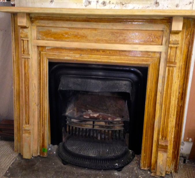 This is a before picture of the fireplace mantle -- It is currently dis-mantled and sitting on sawhorses in the living room. Look for another post about it soon -- when it is finished.