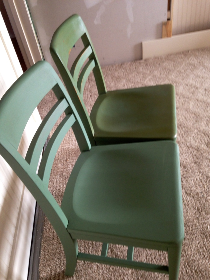 The far chair has had a coat of regular wax and a coat of dark wax. The other chair has only been painted.