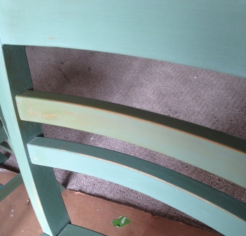 Dark wax on one rung of the chair...