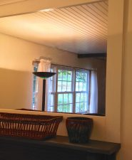 mirror above the mantel