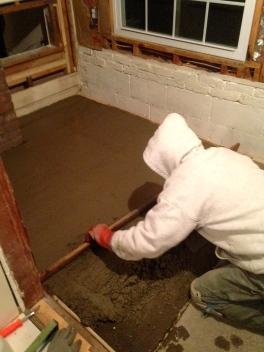 Mr. H.C. leveling the mudroom floor