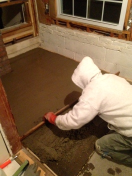 Mr. H.C. leveling the mudroom floor