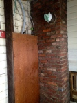 ugly chimney and panel box in mudroom