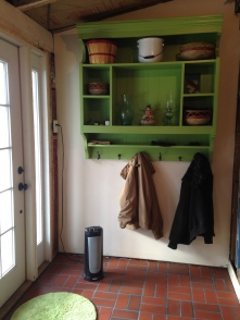 ...the desktop reimagined as a coat rack and painted green (Blooming Grove by Benjamin Moore)