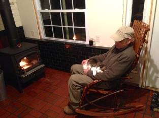 rocking chair by wood stove