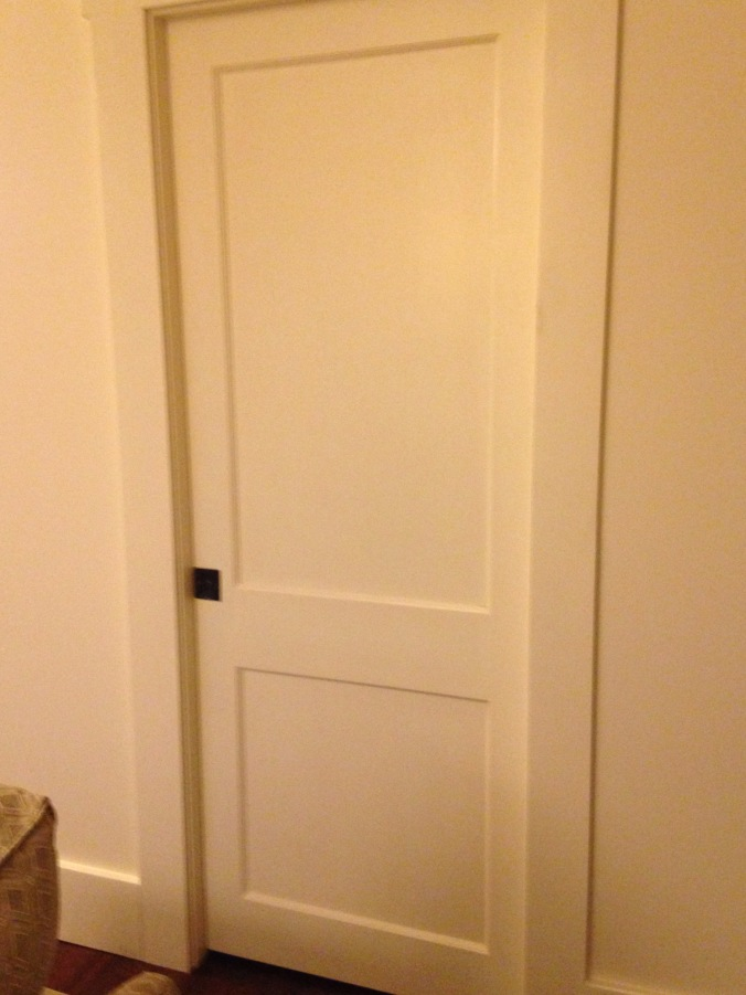 Bathroom pocket door painted in Sherwin Williams Steamed Milk