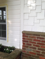 The siding has only one coat of paint still -- hence the yellow tape.
