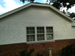 Does there need to be a piece of trim between the siding and the shakes?