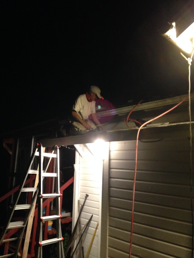 roofing in the dark to beat tomorrow's rain