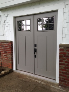 Fiberglass doors by Milliken Millwork, painted Sherwin Williams Dovetail Gray.