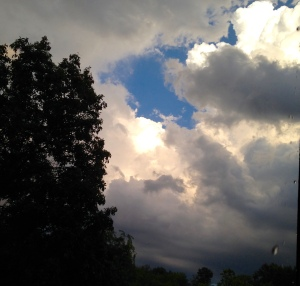 Blue sky behind gray clouds