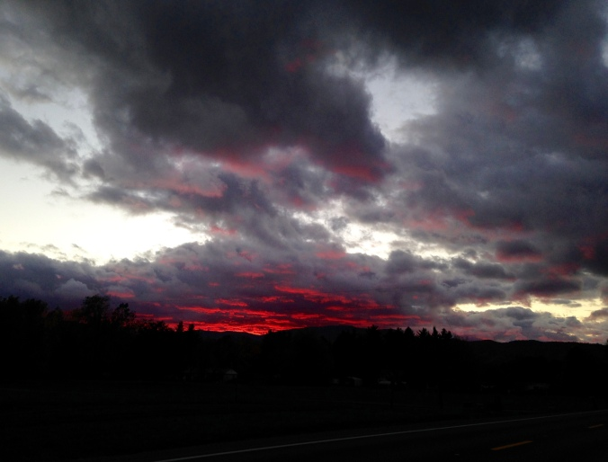 black clouds, red sunset