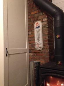 The pocket door next to the wood stove