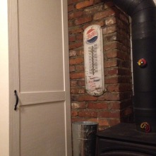 The pocket door next to the wood stove