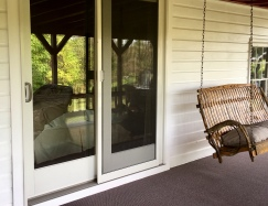 New sliding glass door and restored white siding...