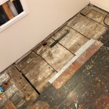 Replacing rotten flooring was Mr. H.C's job.